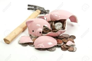 14878879-broken-piggy-bank-filled-with-loose-change-stock-photo